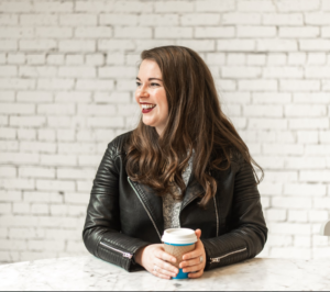 Image of Tori Dunlap with a Cup of Coffee in a Leather Jacket